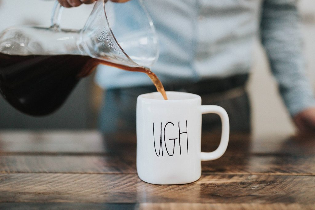 coffee cup with 'ugh' on it